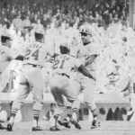 Ken Boyer is greeted at the plate by his teammates after his grand slam in Game 4 of the World Series, Oct 11, 1964
