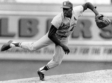 Bob Gibson becomes the seventh pitcher in National League history to strike out the side on nine pitches.