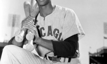 Ernie Banks of the Chicago Cubs sets a record for shortstops by hitting his 40th home run