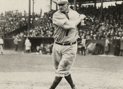 Forty-one-year-old Pirates infielder Honus Wagner reaches Brooklyn Robins hurler Jeff Pfeffer for a grand slam in the 8th inning, helping Pittsburgh beat Brooklyn at Forbes Field, 8 – 2.