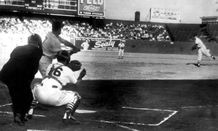 Former pitching prospect Stan Musial throws his only pitch in his 22 year career