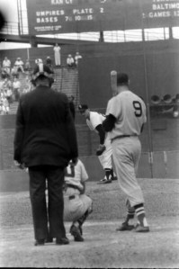 """Boston Red Sox Star Ted Williams stares down White Sox pitcher Dick Donovan in the third inning during a game at Comiskey Park on July 25, 1958. Sherm Lollar is behind the plate and the home plate umpire is Bill Summers. Donovan will record a rare strikeout of the """"Splendid Splinter"""" as the White Sox will be victorious by a 4-0 score."""
