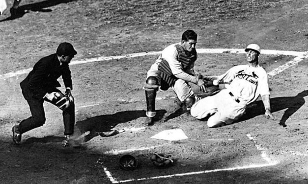George Watkins of the Cardinals vs. Mickey Cochrane of the A's in the 1931 World Series.