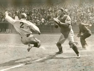 Phillies' Dick Bartell attempting an inside-the-park home run, baring down on Cubs catcher Gabby Hartnett at the Baker Bowl, 9/17/1932.