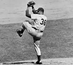Brooklyn Dodgers pitcher Don Newcombe wins the National League MVP; in a few days, he will become the first-ever Cy Young Award winner.