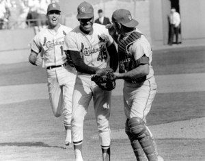 Bob Gibson hits a home run and strikes out 10 batters in leading the St. Louis Cardinals to the World Championship over the Boston Red Sox