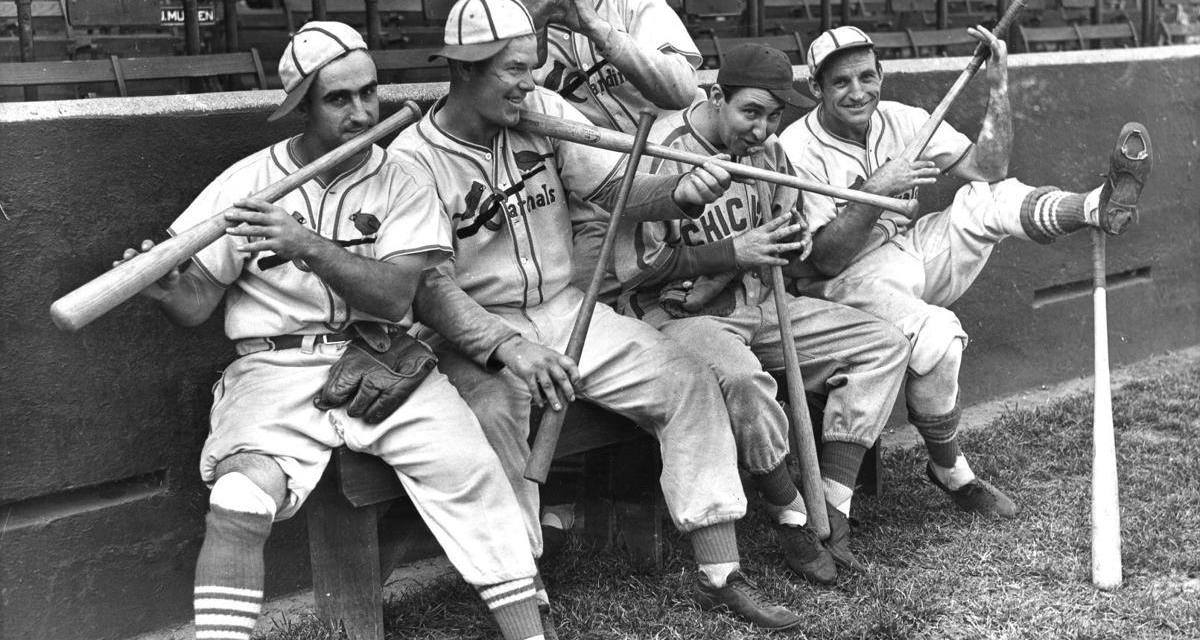 The Gashouse Gang using their equipment as instruments. Stan Bordagaray, Bill McGee, former Cardinal Rip Collins, and Pepper Martin with Bob Weiland standing, 1938.
