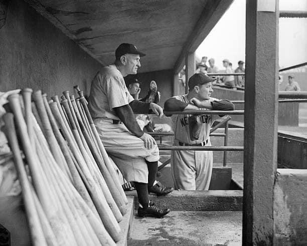 1949—first year Yankees manager Casey Stengel and relief ace Joe Page.