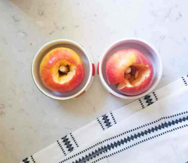Cored apples placed in round bowls.