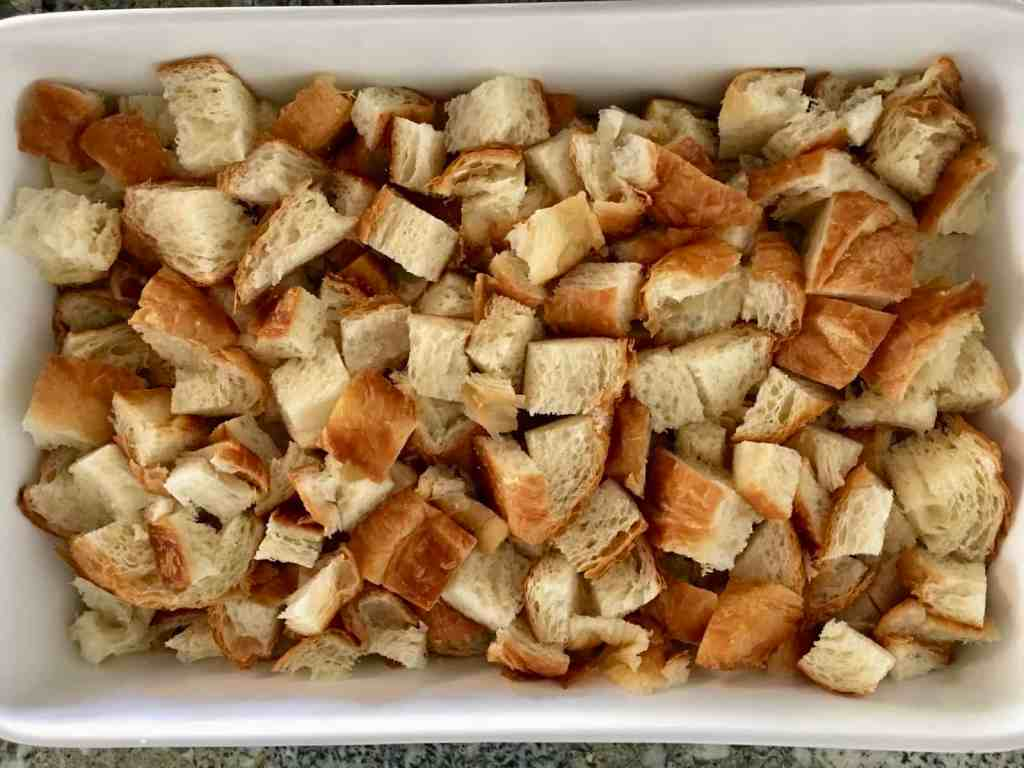 cubes of croissant on top of the apple cinnamon mixture