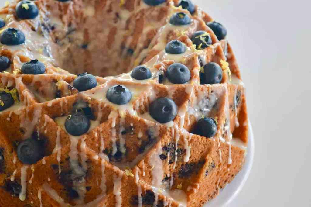 blueberry lemon bundt cake with honey lemon glaze baked in a jubilee cake pan