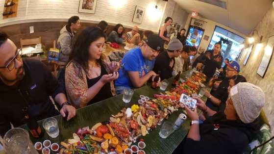 Breaking bread with our Filipino Canadian hosts