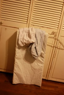 $10 // Changing pad with strap and two covers, white and blue.