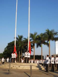 HK and China flags being raised