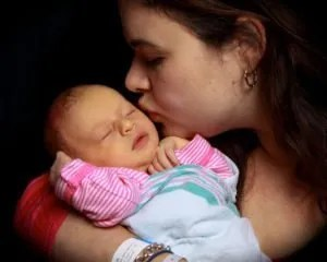 Me and my older daughter, one day old.