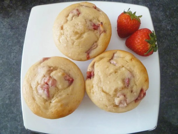 If you love summertime food, Skinny Strawberry Lemonade Muffins are the perfect snack for you. Each muffin is bursting with strawberry lemon flavour. You can almost drink it up! #muffins #recipe #lemonade | thishappymommy.com