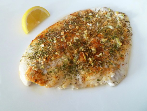 Lemon Baked Cod -- the combination of lemon, spice, and garlic give this mild fish a real delicious flavour | thishappymommy.com