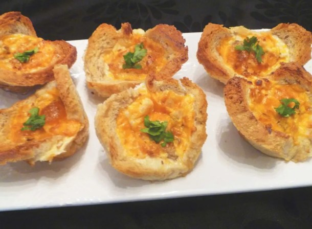 Mushroom Omelet Bread Cups -- Toasted bread cups filled with eggs, sautéed mushrooms, roasted red peppers and cheese.   thishappymommy.com