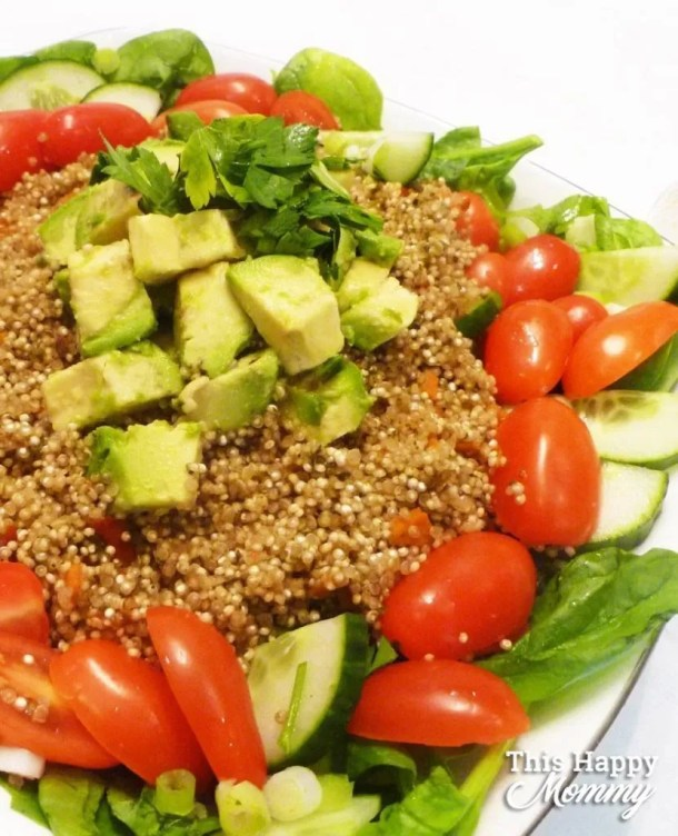 WARM AVOCADO QUINOA SALAD -- My family loves this salad! It's perfect for lunch or dinner. If you love big, tasty salads, Warm Avocado Quinoa Salad is all that and more. With warm quinoa served on a bed of spinach, avocado, cucumber, cherry tomatoes, and covered with a light lemon dressing, this salad is sure to please. healthy and easy family meals | meatless monday | low carb vegetarian meals | Healthy Clean Eating Salad Recipes | Quinoa Salad Recipes | Healthy Salad Bowl Dinners | #salad #recipe #healthyrecipe #meatlessmonday #dinner | thishappymommy.com