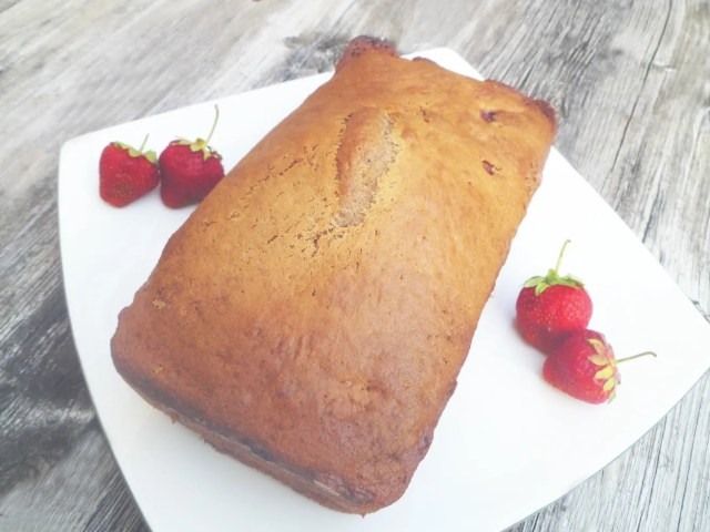 Strawberry Bread -- Moist and lightly sweetened vanilla bread with bits of strawberries baked throughout. | thishappymommy.com