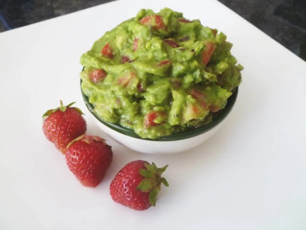 Strawberry Guacamole -- Smooth and creamy guacamole with chunks of sweet strawberries. | thishappymommy.com