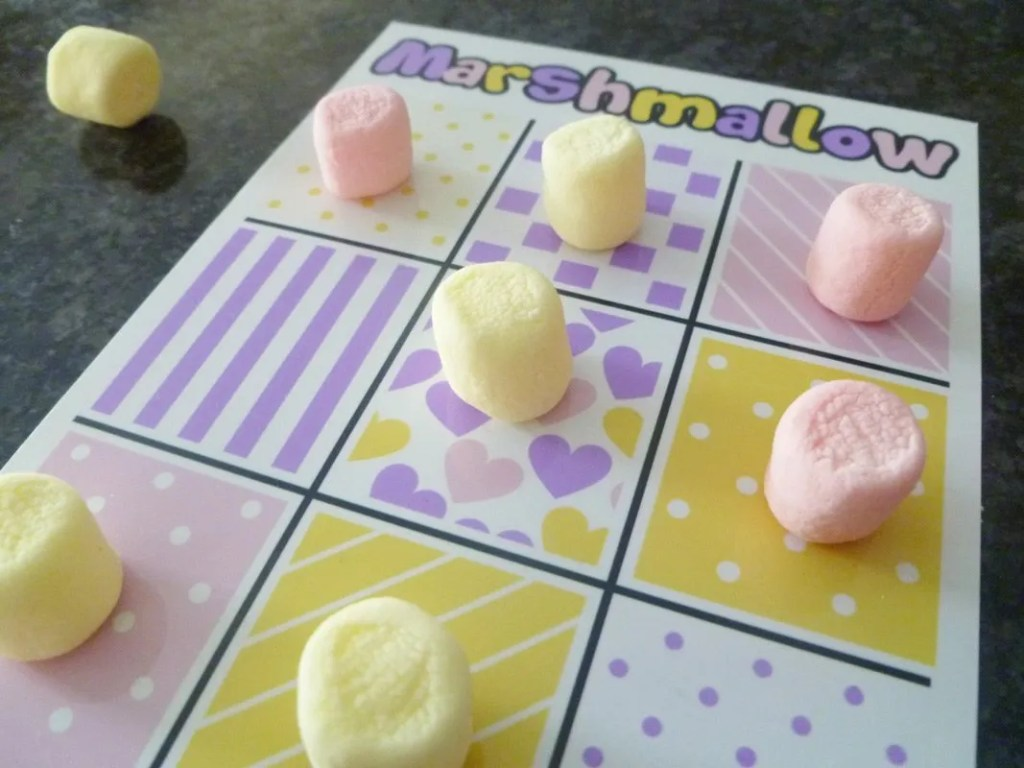Marshmallow Tic Tac Toe -- Our family's new favourite game is a fun and tasty version of Tic Tac Toe. You can download your own copy for FREE! | thishappymommy.com