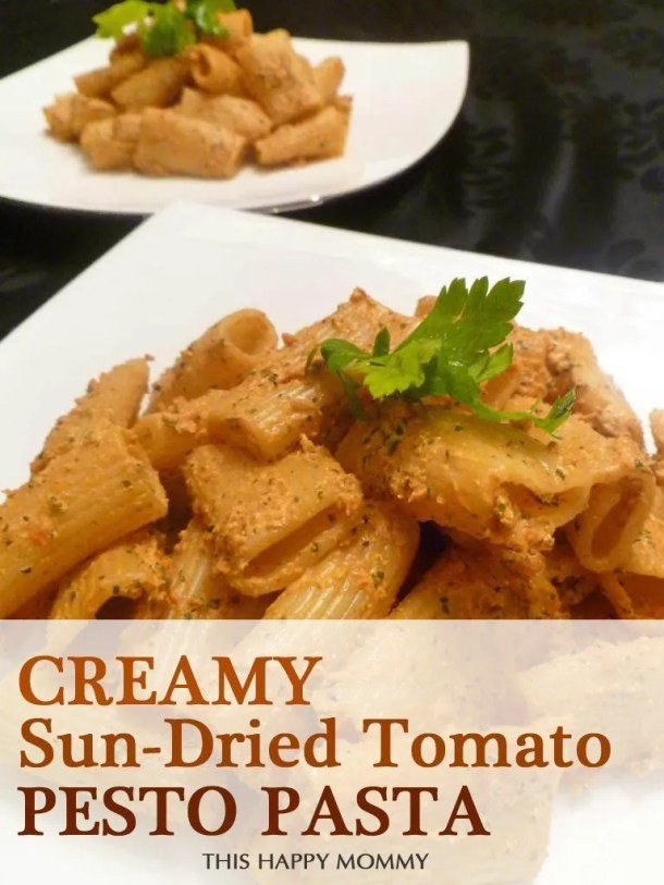 Creamy Sun-Dried Tomato Pesto Pasta -- A family favourite dish! With only four ingredients, this is one simple and delicious dinner. The combination of sun-dried tomatoes, fresh basil, sautéed garlic and cottage cheese creates a truly luscious pasta sauce. #easyrecipe #dinner #kidfriendlyfood | thishappymommy.com