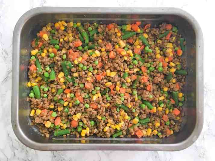 lentils and mixed vegetables in baking dish