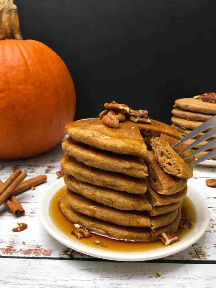 pancake stack with fork grabbing a bite