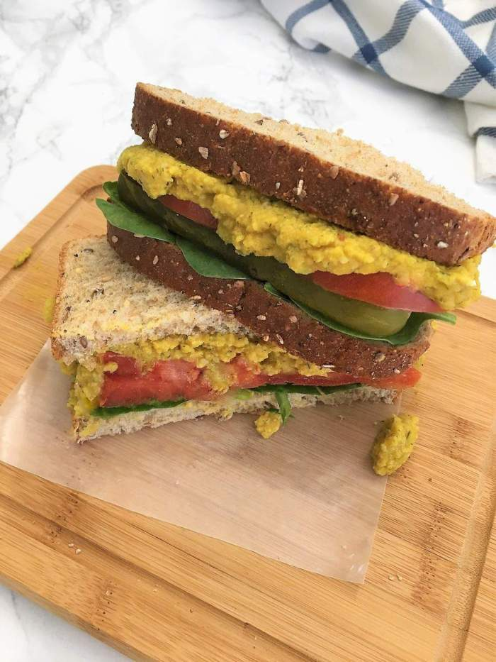 Chickpea Salad Sandwich cut in half and stacked on an angle