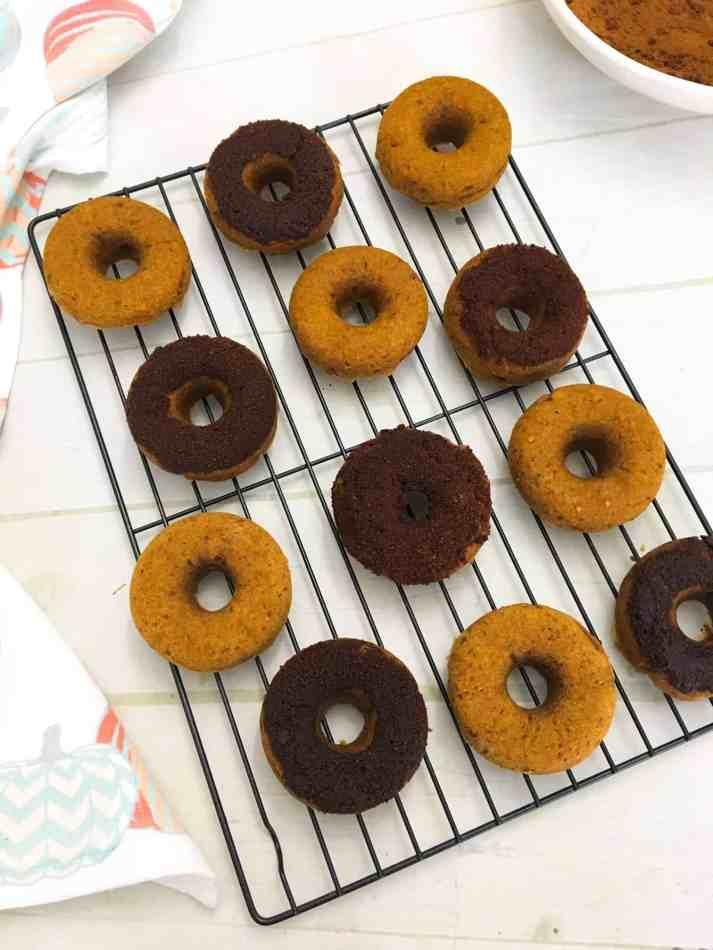 Pumpkin donuts on wire rack