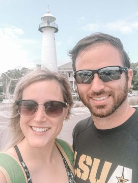 My husband and I stand in front of the Biloxi Lighthouse on a vacation to Mississippi.