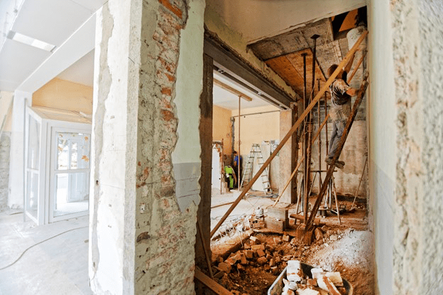 interior room of house under construction with dirt floors