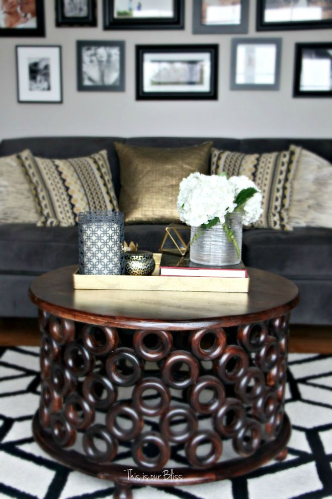 how to style a coffee table - coffee table styling - formal living room couch - gallery wall - elements of a well-styled coffee table - gold detail - back to basics - This is our bliss