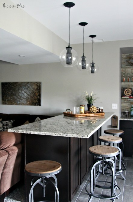 Basement bar industrial barstools modern industrial lights neutral decor baement project progress This is our Bliss