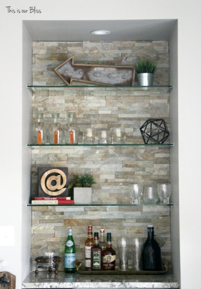Basement bar rustic industrial barstools stacked stone wall & bar shelves neutral decor basement project progress This is our Bliss