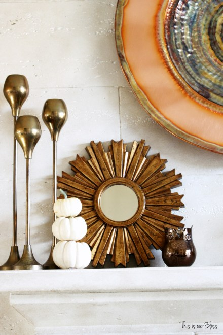 fall mantle - mantle styling - copper gold - mini pumpkins - gold sunburst - fall vignette - brass candlesticks - fall vignette - This is our Bliss
