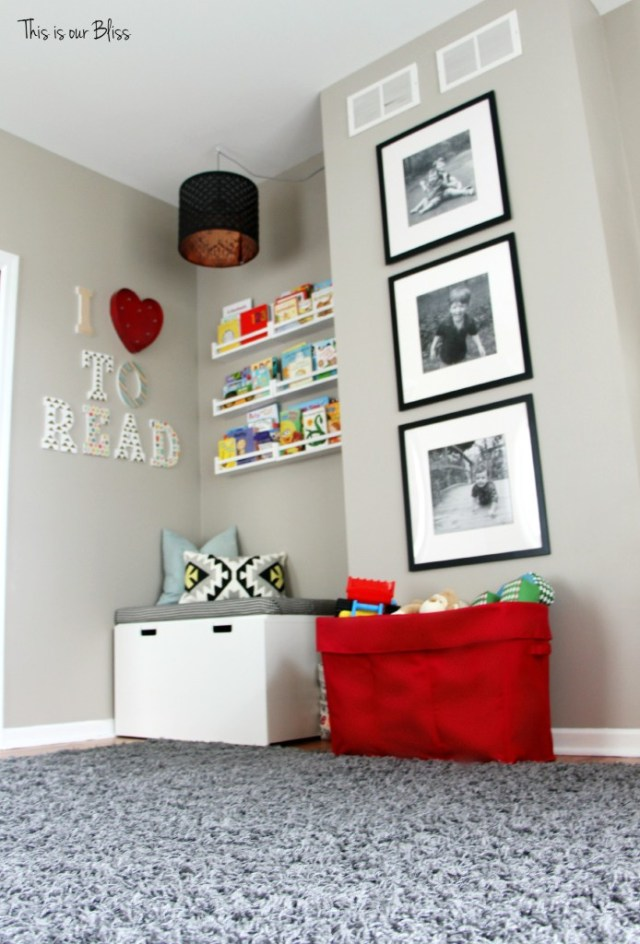 Playroom reading nook playroom gallery wall 3 black frames mini playroom picture wall This is our Bliss