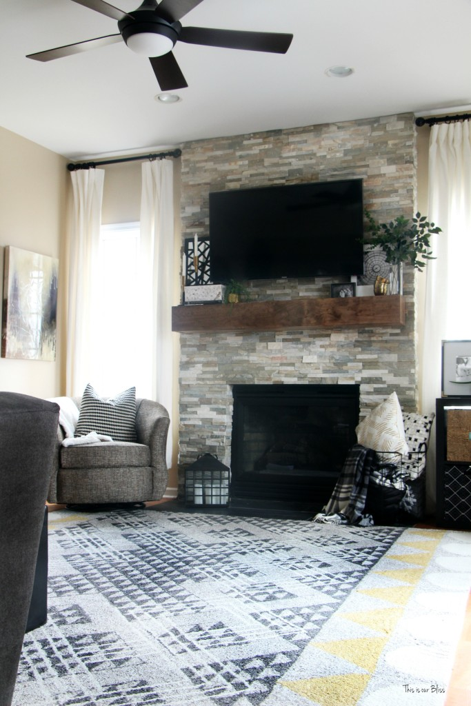 How to style a mantle table top styling hop family room mantle styling and rug This is our Bliss www.thisisourbliss.com