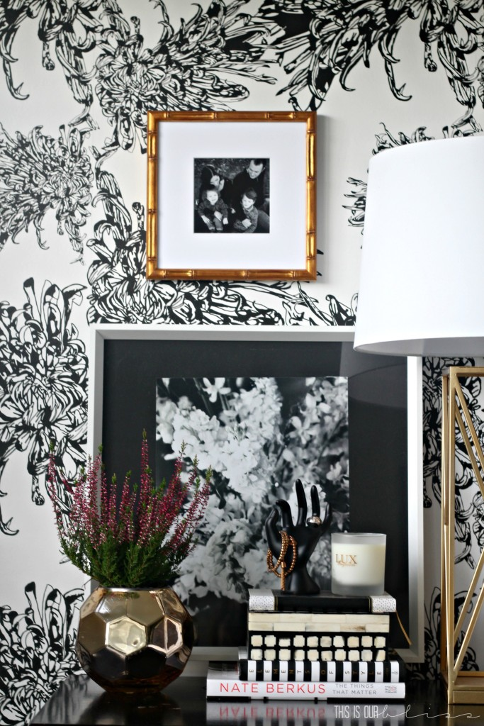 Classy and chic black and white wallpapered bedroom accent wall! Perfect nightstand styling too! | This is our Bliss | www.thisisourbliss.com