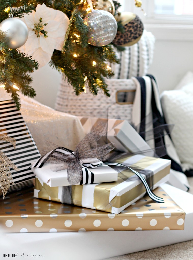 A Merry and Metallic Christmas Home | 12 Days of Holiday Homes Tour 2016: This is our Bliss Christmas Living Room | Neutral, metallic, patterned wrapped gifts || www.thisisourbliss.com