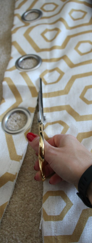 how to reupholster a headboard with a curtain panel - cutting grommets off - this is our bliss