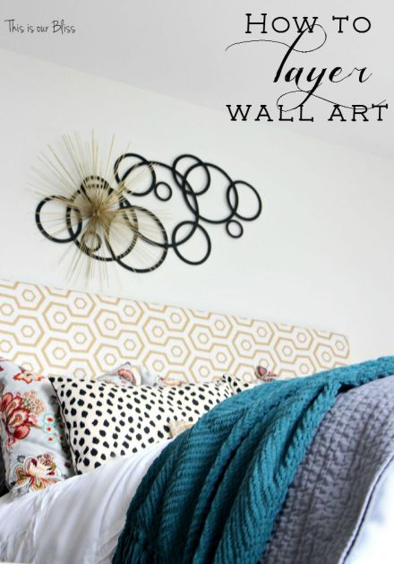 layered metal wall art - how to layer wall art - wide shot of bed - Guestroom revamp - pattern play - floral, dalmation, geo, gold - This is our Bliss