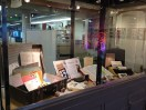 A display case is part of the exhibition. This space provided an opportunity to educate the public on the mail art movement.