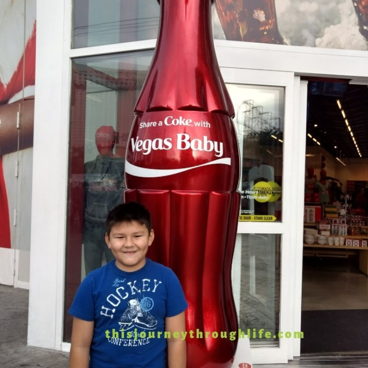 What can you do in Las Vegas with kids? Find out right here! Kid-friendly activities. Coke Bottle outside Coke store,