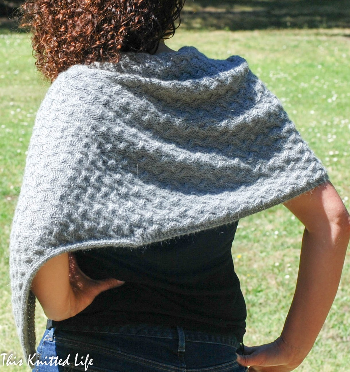 A simple poncho knit from a seamed rectangle.