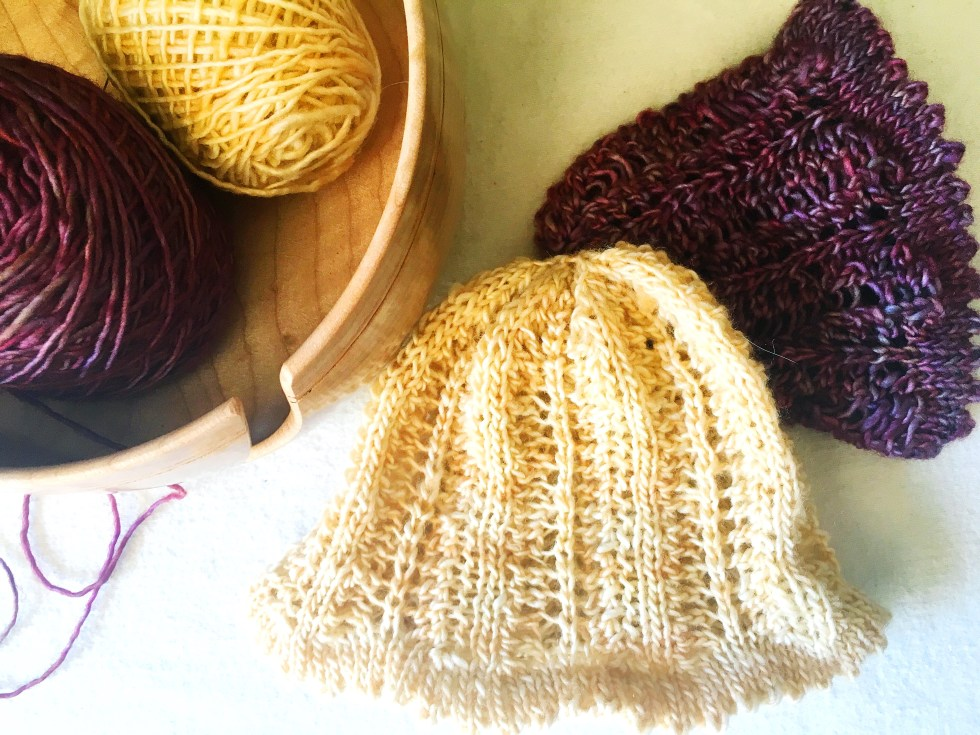 Hand knit baby hat in Madelinetosh Tosh Merino Light. With just the perfect amount of lace and a faux-picot brim.