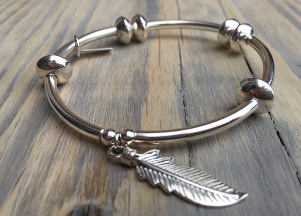 Beautiful, handmade, silver ChloBo noodle disc feather bracelet