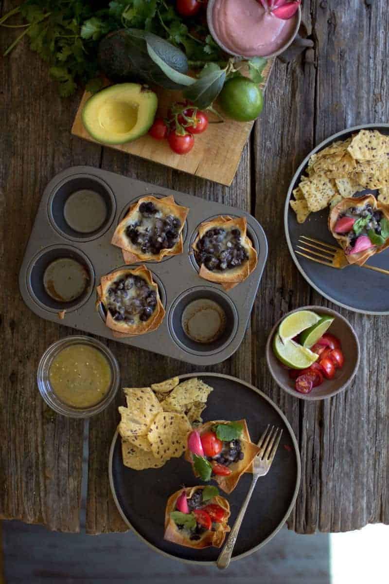 Crispy Black Bean Taco Cups recipe by @beardandbonnet on www.beardandbonnet.com