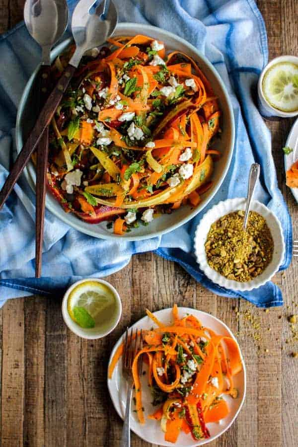 Carrot, Feta, and Pistachio Salad with Orange Blossom Toss recipe from @KaleandCaramel || Beautiful heirloom carrots thinly shaved & tossed with an incredible orange blossom scented dressing, herbs, pistachios, & feta. || @thismessisours #glutenfree #vegetarian